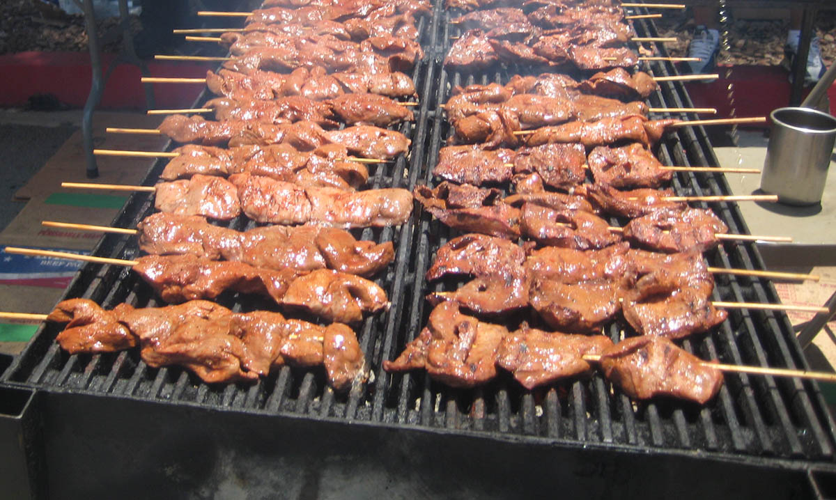 Anticuchos on a grill are a delicious Peruvian street food.