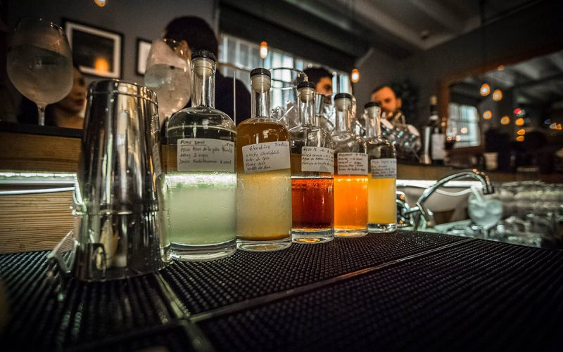 Five unique cocktail mixes of Barra 55 sitting behind the bar.