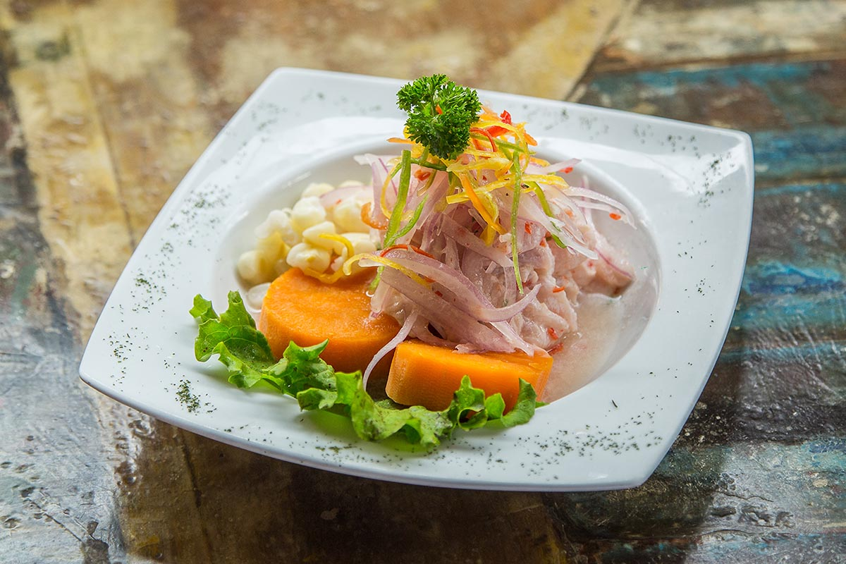 One of the top Peruvian foods, ceviche is fish in lime juice with onions, corn and sweet potato.