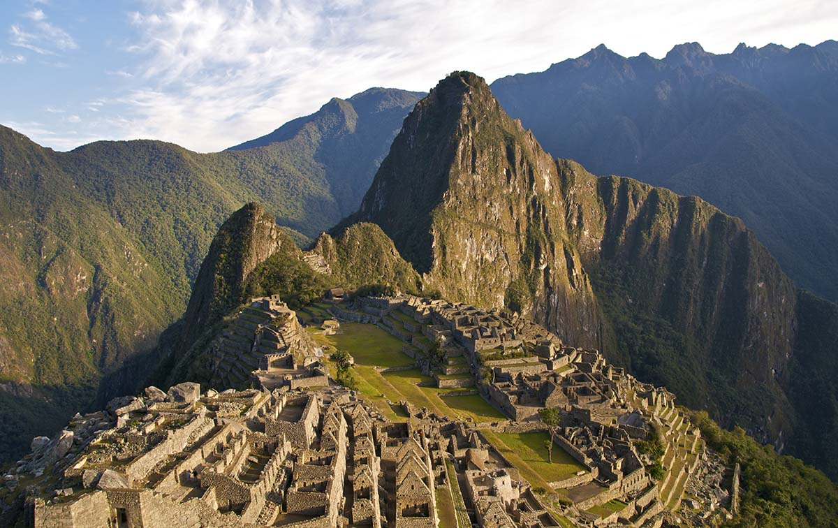 """The classic """"postcard"""" shot of Machu Picchu taken in golden light from the Guardian House."""
