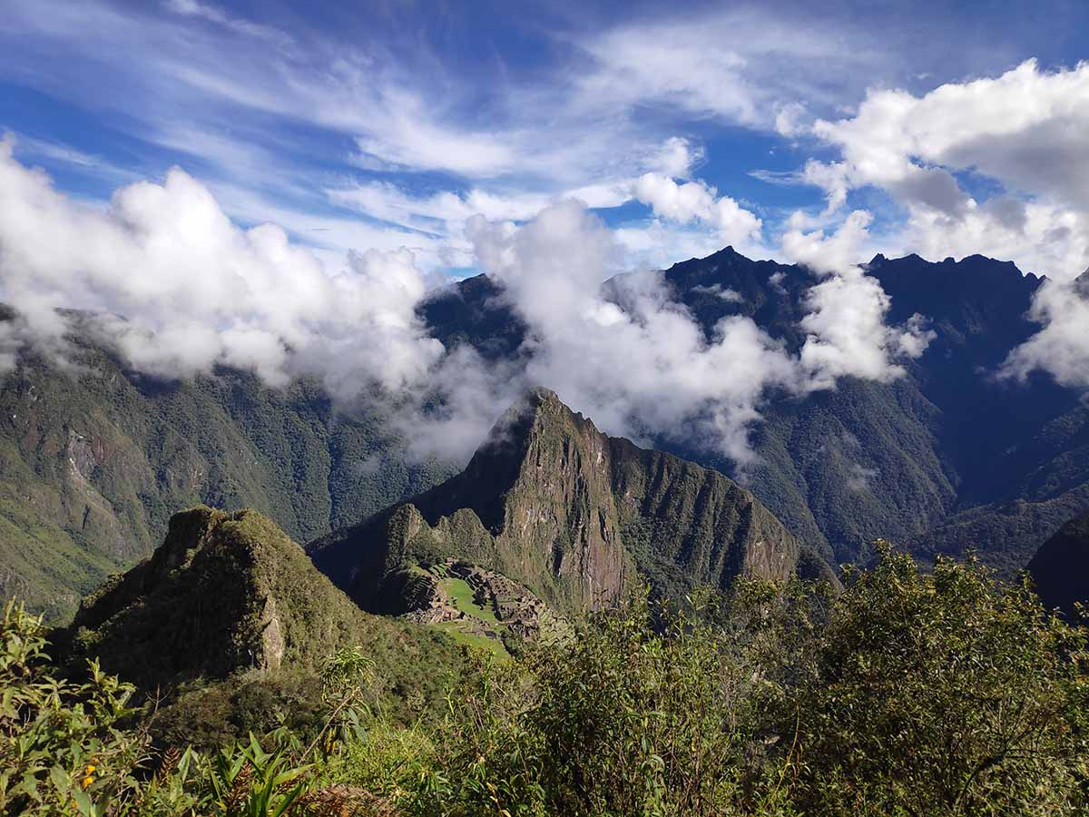 The view looking down on the Machu Picchu ruins from the Machu Picchu Mountain summit. Machu Picchu appears much smaller than from other views.