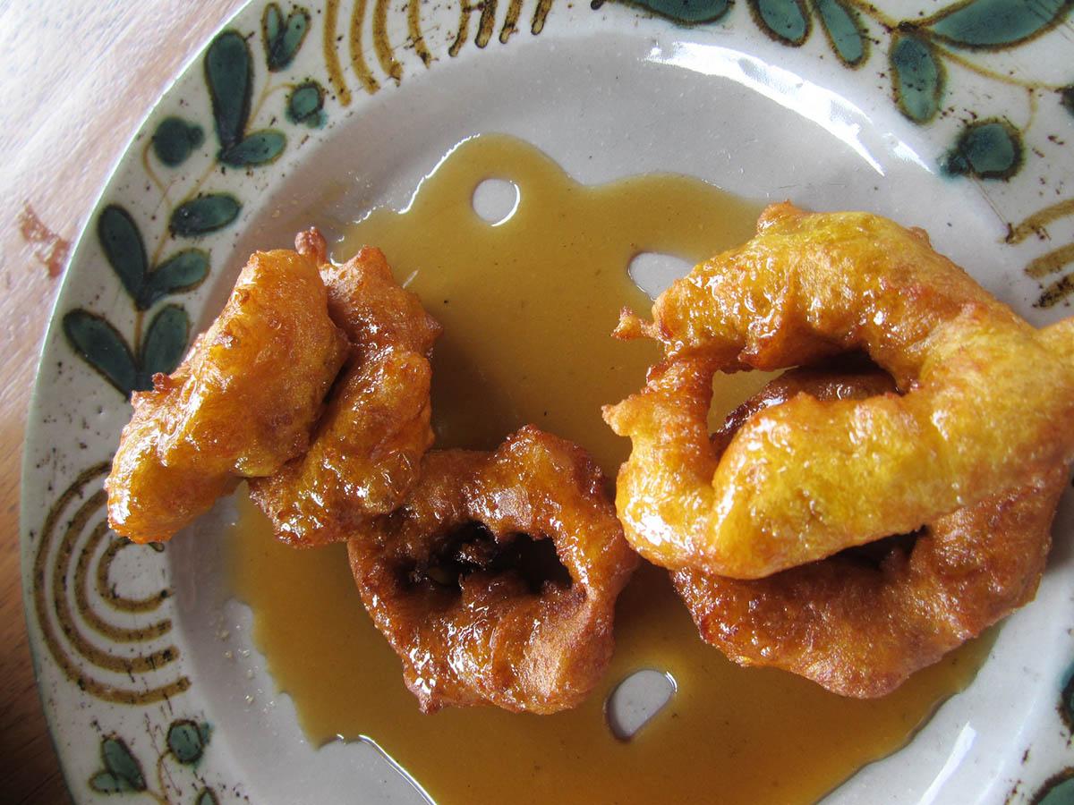 Picarones, sweet potato or pumpkin doughnuts served in Peru.