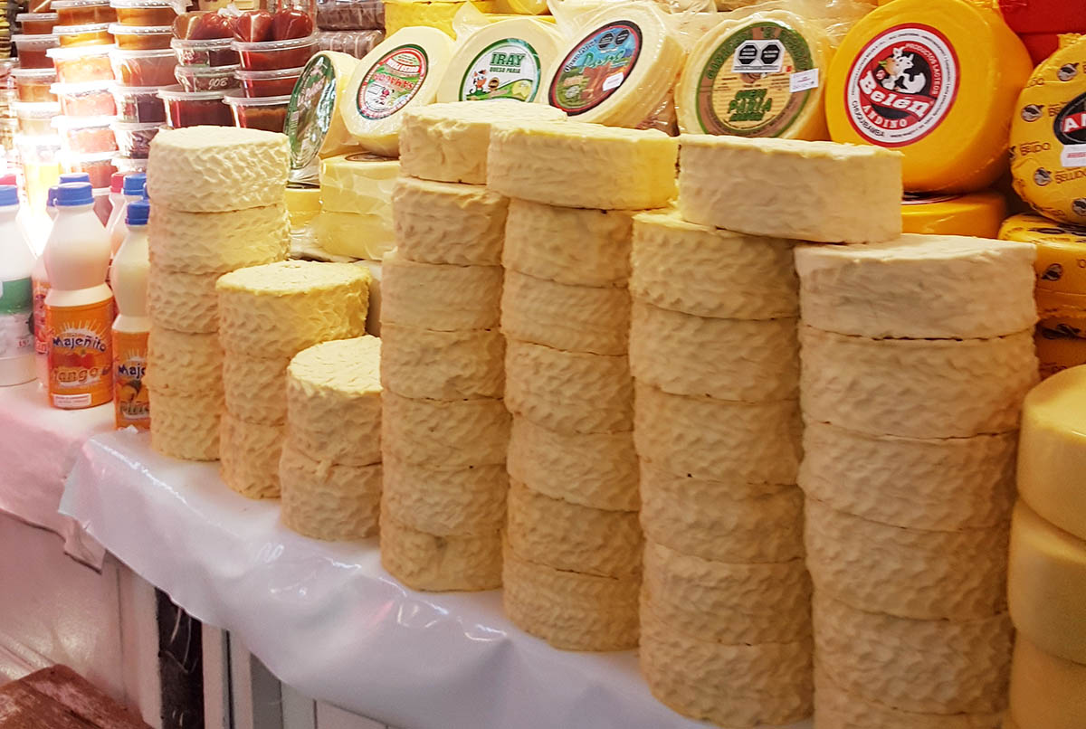 Stacks of queso fresco, or fresh cheese, sold in a Peruvian market.