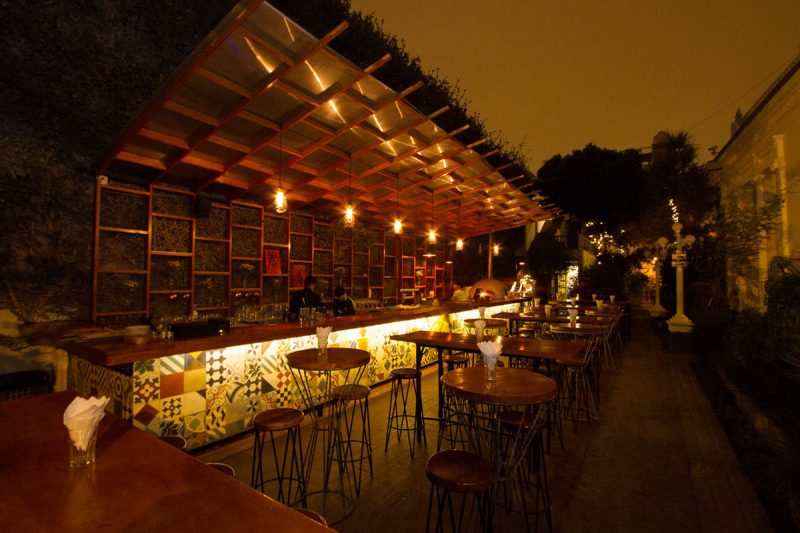 Low light, empty outdoor bar and terrace at DaDA bar in Lima.
