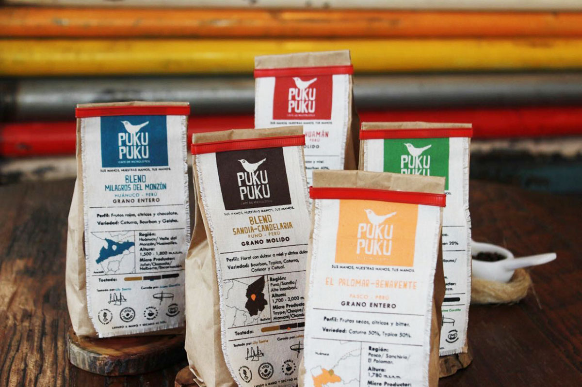 Four bags of Puku Puku organic coffee featuring different Peruvian coffee blends.