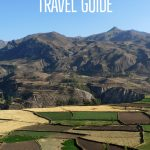 """Colca Canyon Travel Guide"" in white on the blue sky above mountains and patchwork fields"