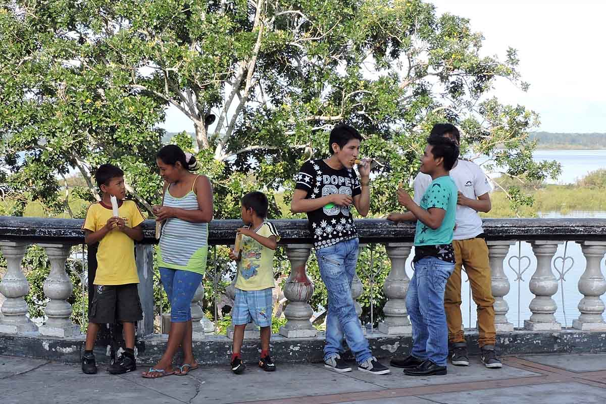 A family of 6 enjoys a snack on the Malecon Tarapaca in Iquitos, Peru.