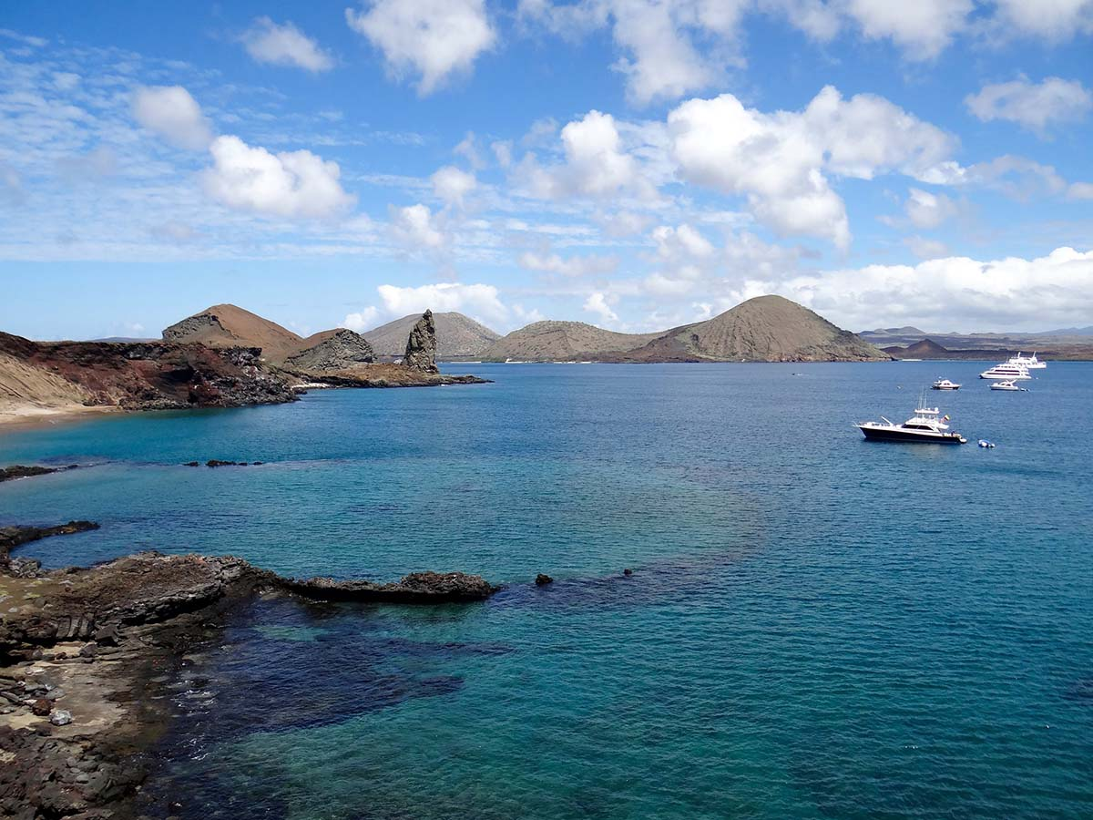 Cruise ships and yachts can be seen anchored off the shores of Playa Dorada and Pinnacle Rock