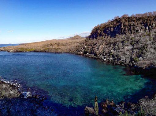 The turquoise bay and sea vistas on the trail to the top of Cerro Tijeretas on San Cristobal Island.
