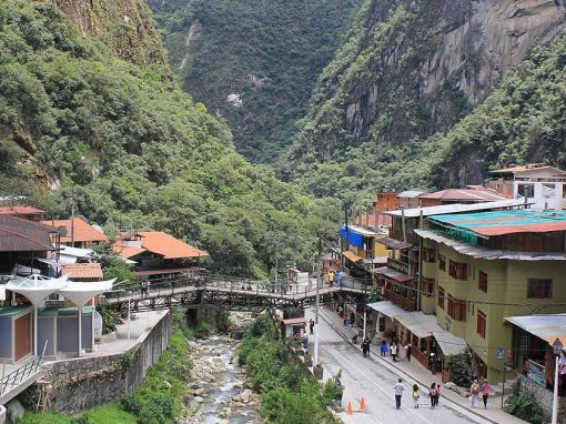 Hotels and stores in Aguas Calientes lining the river and street through town.