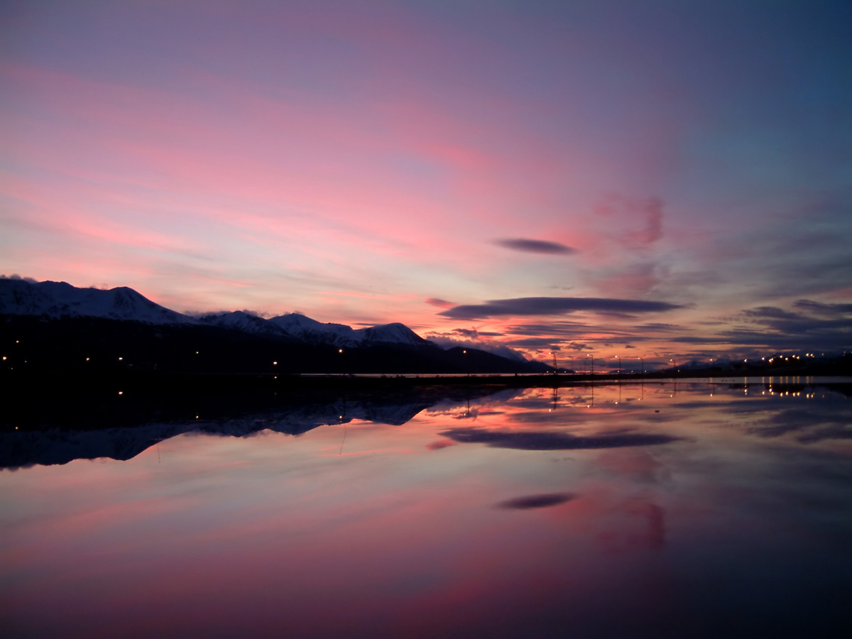 Sunset with shades of bright pink over the Beagle Channel and Ushuaia.