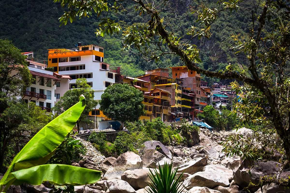 The Urubamba River rushing past the colorful buildings of Aguas Calientes (Machu Picchu Pueblo).