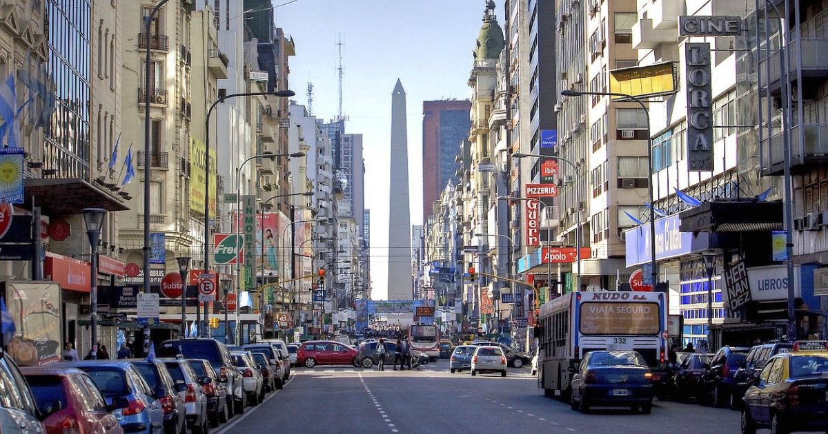 Bustling city street of Buenos Aires, Argentina with cars, buildings, and the iconic obelisk.