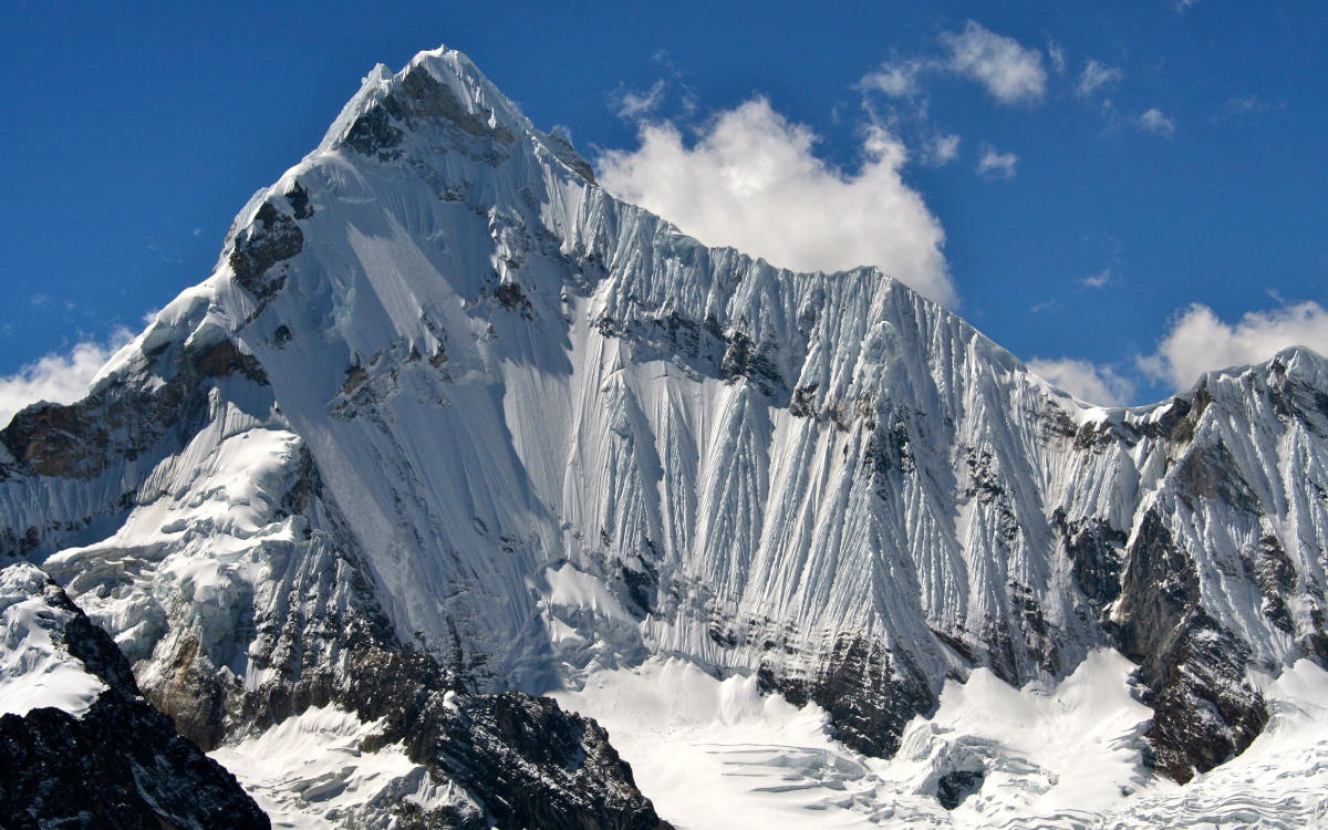 Steep snow-covered peak of the Yerupaja Mountain, which can be see on the Huayhuash Circuit Hike.