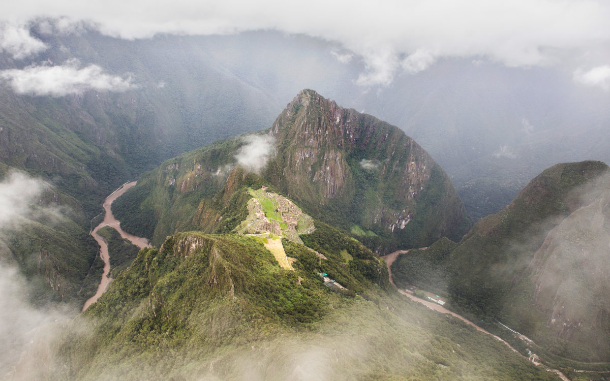 The citadel of Machu Picchu from the summit of Machu Picchu Mountain on a misty day.