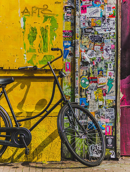 Bike against a painted and graffiti'd wall in Lima