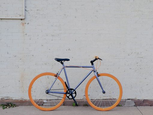 A bicycle against a wall in Lima, Peru