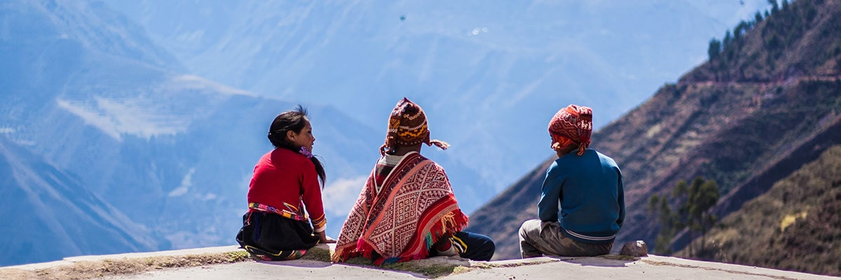 Native kids looking out over the Sacred Valley in Peru