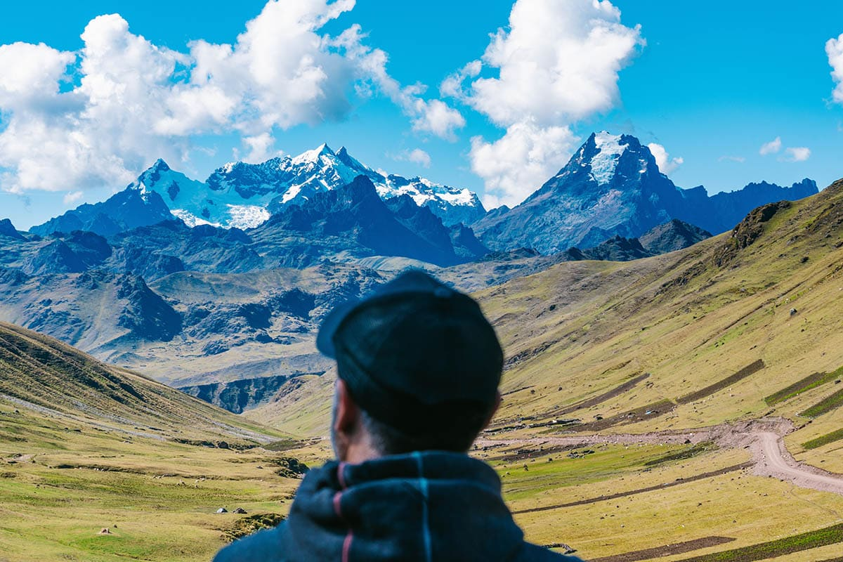 A man looking out at a valley in the Andes