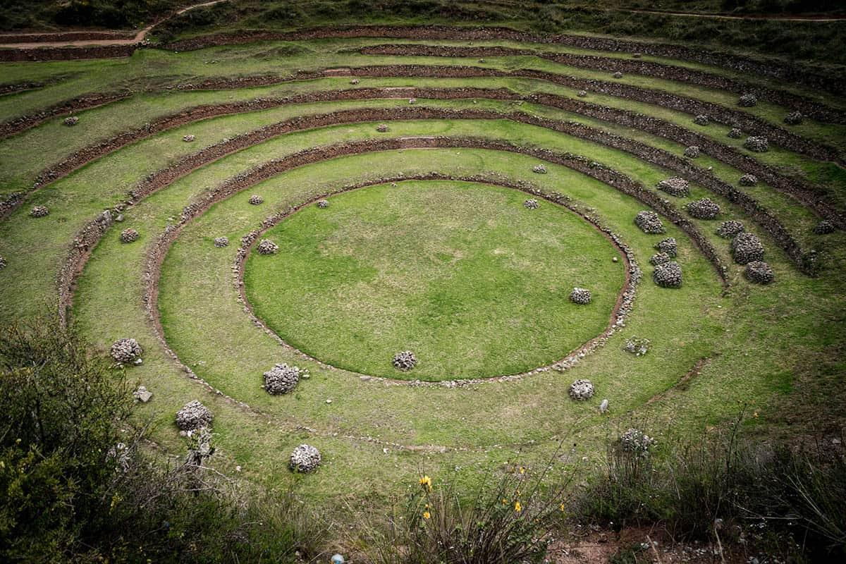 Close up of the circular green grass terraces of Moray, Peru