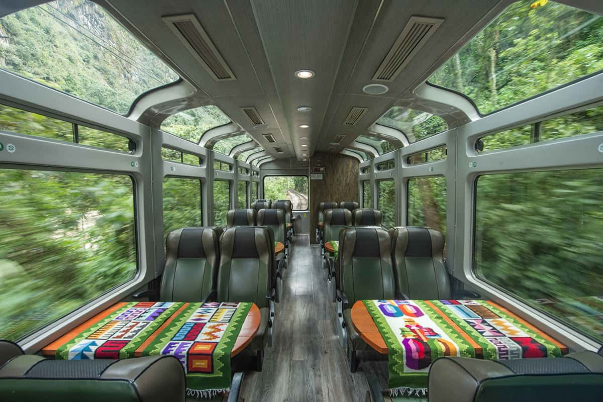 Comfortable rows of seating and large panoramic windows inside the PeruRail Vistadome Train to Machu Picchu.