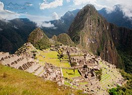 Machu Picchu ruins on a sunny day with Huayna Picchu from afar