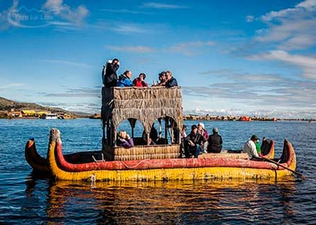 Reed houses and locals going about their daily work on a reed island in Lake Titicaca.