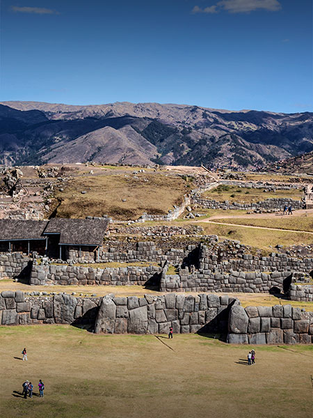 Sacsayhuamán, an Inca ruin featuring enormous stones fitted perfectly together to form walls.
