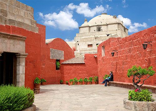 A popular viewpoint through arched sillar walls of Arequipa City from the Yanahuara District, a trendy residential area
