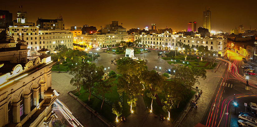 Plaza de Armas of the historic center of Lima Illuminated at night with Peruvian colonial buildings on the perimeter