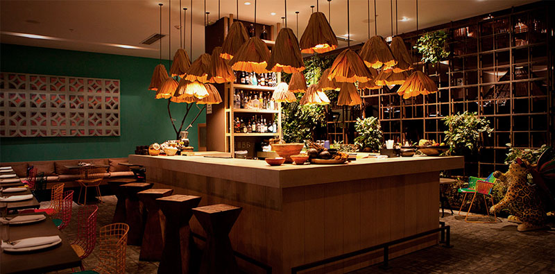 Amaz Restaurant in Lima with plants and wooden accents, a top restaurant in Lima known for its Amazonian cuisine