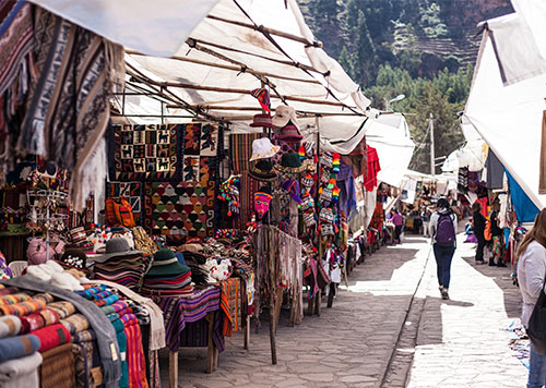 Colorful Artisan Market in the village of Pisac located in the Sacred Valley, where local vendors sell handmade souvenirs.