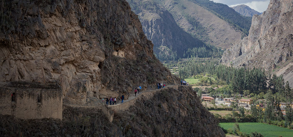 Cliffsides overlooking the valleys of Ollantaytambo, a village in the sacred valley that is home to a famous Inca fortress
