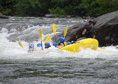 Travelers hitting the rapids on the Urubamba river on a Sacred Valley rafting tour, a popular option for adventure lovers