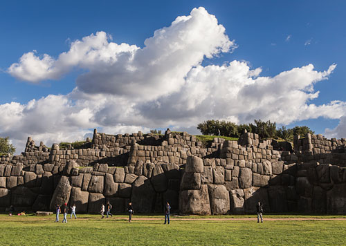 Sacsayhuaman, an ancient citadel with megalithic stones that predates even the Inca, with white clouds and blue skies