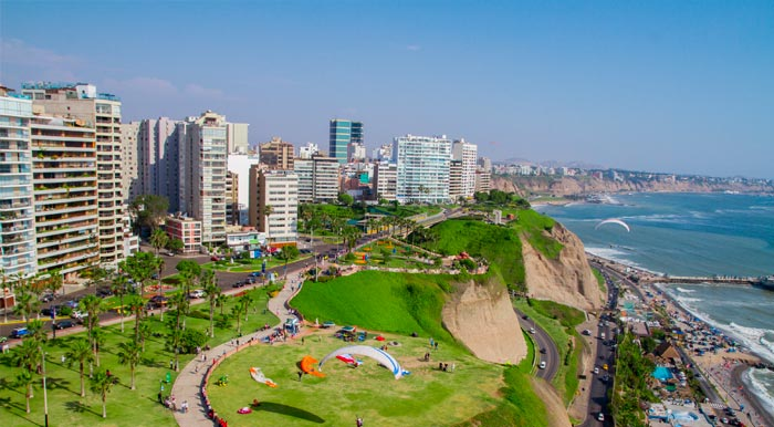 The Costa Verde and Pacific Ocean with the Miraflores skyline and some paragliders visible.