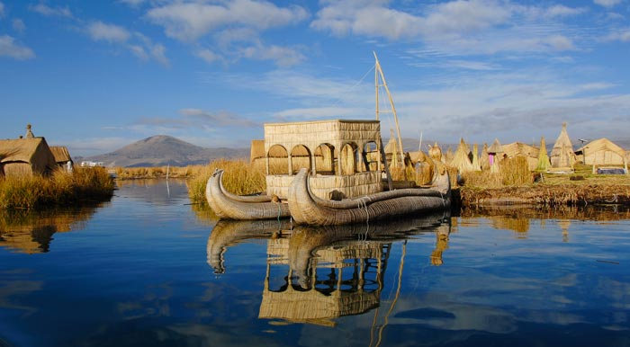 A totora reed boat and a few of the man-made floating Uros Islands on Lake Titicaca.