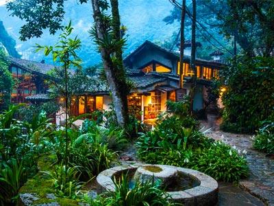 Lush greenery and trees surrounding the luxurious Inkaterra Machu Picchu Pueblo Hotel.
