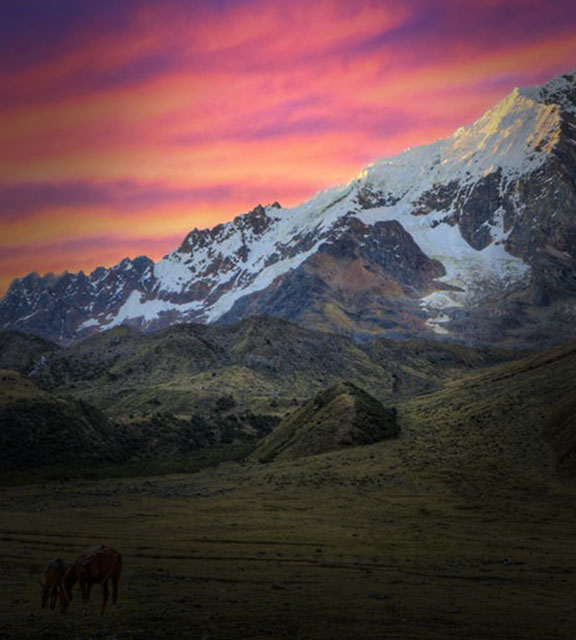 Beautiful sunset with snowcapped mountain peaks on the Salkantay Trail