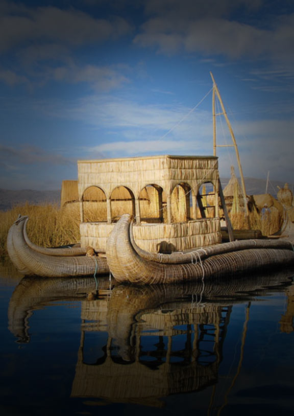 A reed boat floating near an Uros Island. The boats are made of the same material as the islands