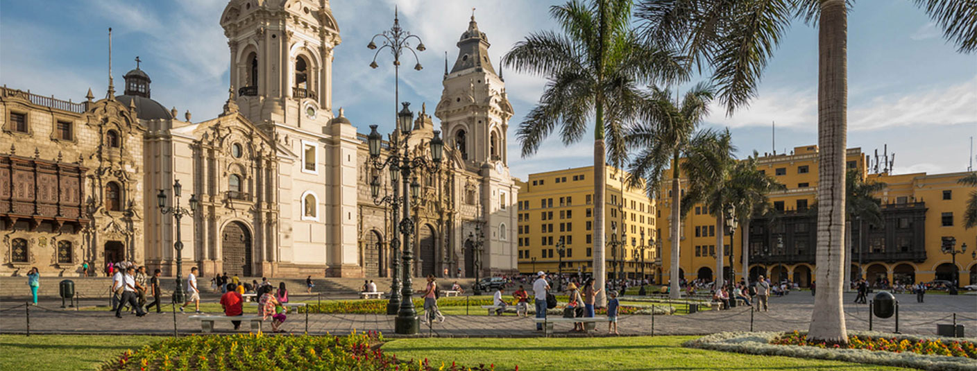 Visitors at the Plaza de Armas in Lima, the city's main square surrounded by historic buildings.