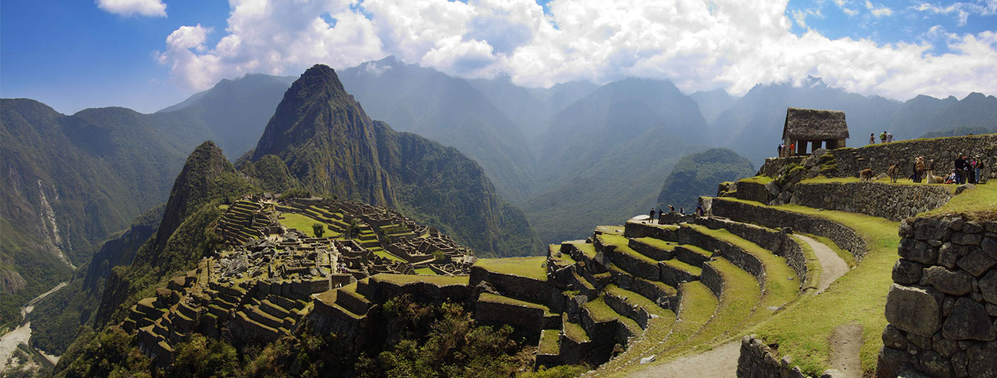 A view of the ruins of Machu Picchu and surrounding mountains as seen from the watchman's hut.