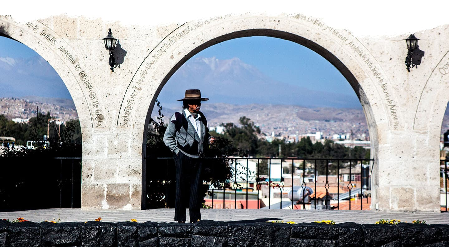 Old man walking in front of a view point in Arequipa