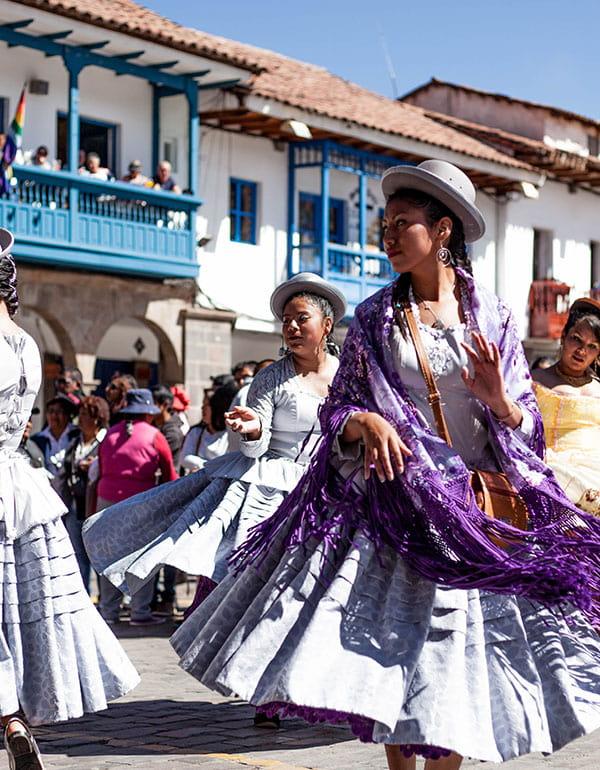 Woman dancing during Inti Raymi celebration in Cusco