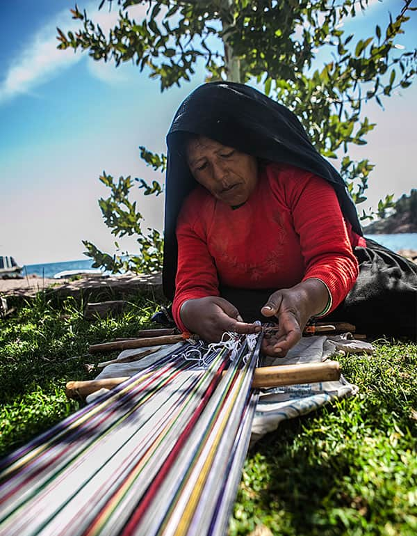 Woman weaving at Taquile Island on Lake Titicaca