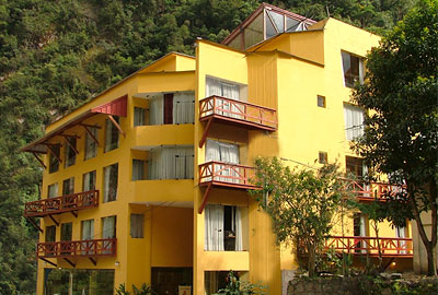 Outside of the hotel showing its several floors and the trees and hills around it | Hatuchay Tower | Peru for Less