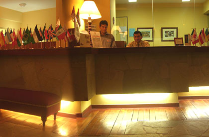 Check in desk featuring flags of many different countries | Hatuchay Tower | Peru for Less