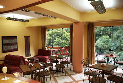 Bar/lounge area with views of the surrounding greenery | Hatuchay Tower | Peru for Less