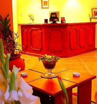 Reception area with flowers everywhere | Inti Orquideas Hotel | Peru for Less