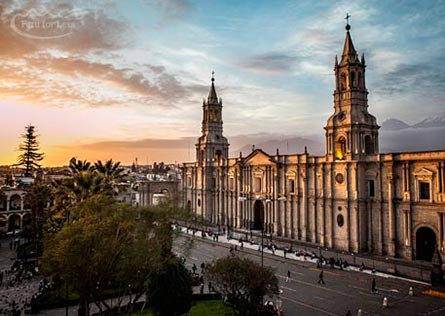 View over the white Arequipa Basilica Cathedral as the sun sets